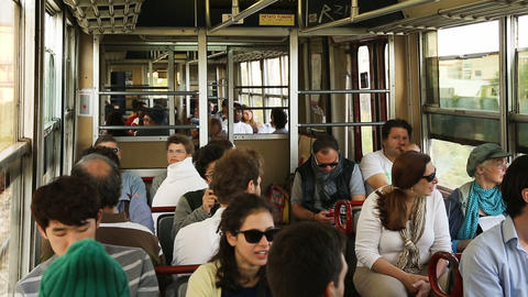 People sitting in car of city train moving rapidly along open air rail at day Footage