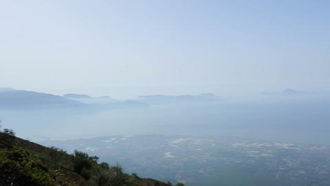 City lying at foot of volcano mountain, overview of Naples from Vesuvius in haze Footage