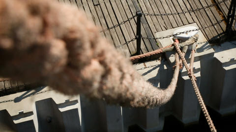 View from ship on rope tied to a pier, water transport, port and adventure Footage