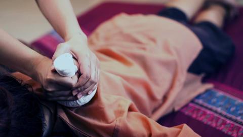 Traditional Thai massage or Thai yoga massage Footage