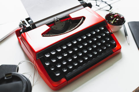 Workplace with bright red vintage typewriter Photo