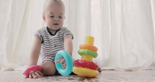 Adorable baby playing with toys ビデオ