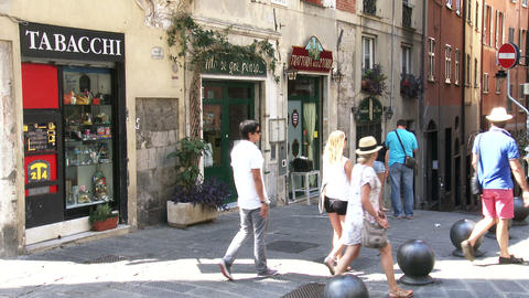 Tourists walking in characteristic small streets in Genoa, Italy Footage