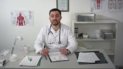 Smiling medical doctor showing thumbs up Live Action