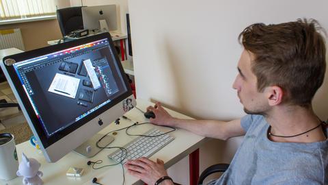 web designer decorates image in program at office Live Action