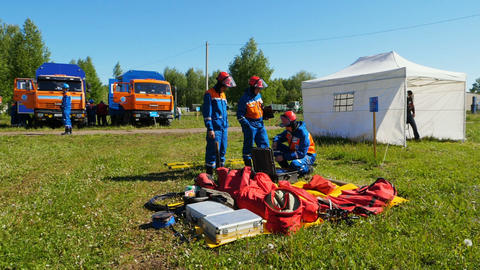fire brigade students prepare for training looking at equipment GIF