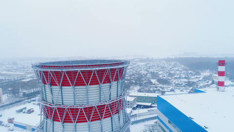cooling heat tower upper part and snow falls down Archivo