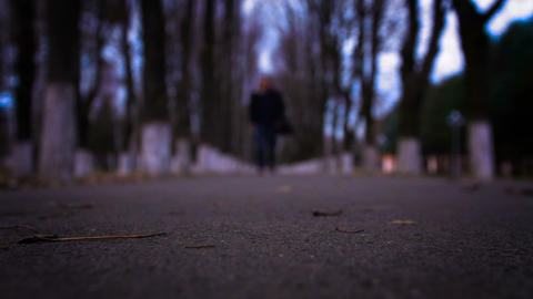 Silhouette of a man on a walk, approaching the frame shot at a rate of 100 Live Action