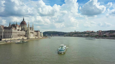 Sightseeing boat on River Danube with Parliament of Hungary on a sunny day Footage