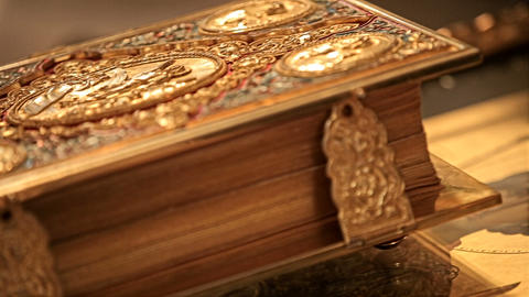 Expensive inlaid church book lies on the table GIF