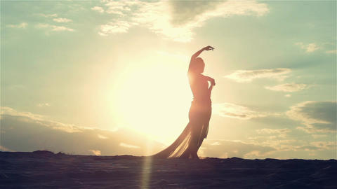 Silhouette Of Dancing Woman At Sunset 0