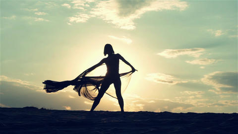 Silhouette Of Dancing Woman At Sunset 1