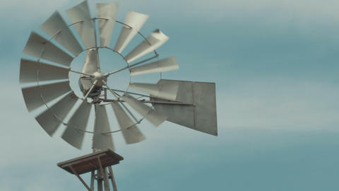 Old fashioned Windmill / Wind mill spinning in the wind Footage