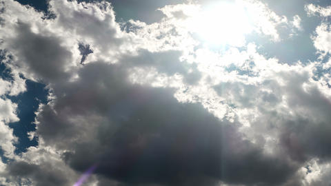 Time lapse of clouds and the sun movement Footage