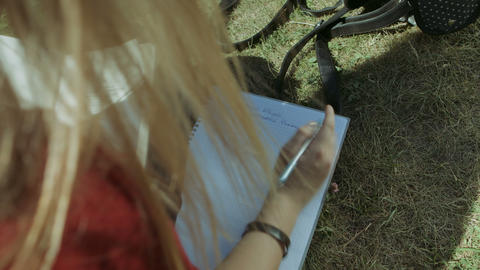 Female student's hand with pen writing in notebook Footage