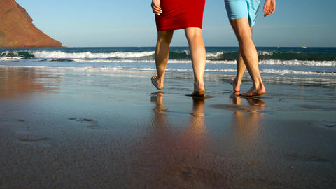 Couple in love carefree walking to the water on the beach. Picturesque ocean Footage