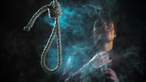 Social commercial Man smoking cigarette Noose loop Footage