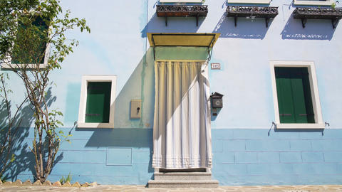 Exterior of blue house on Burano island, colorful building in Venice, summer Live Action