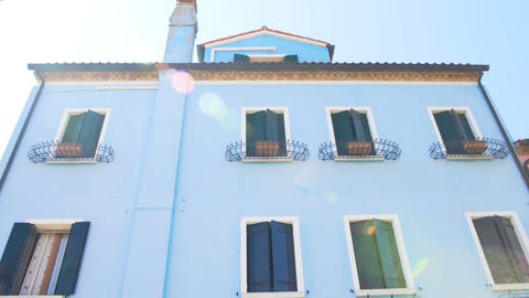 Panorama of wonderful blue house in Burano, neighborhood, doll-like building Footage
