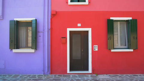 Amazing colorful buildings on Burano island, purple and red houses in Venice Footage