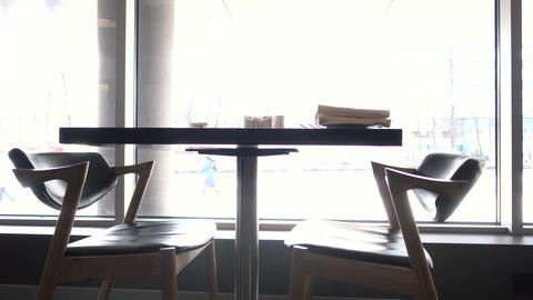 Table in restaurant for two against window Footage