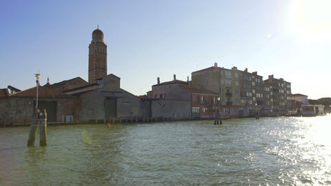 Beautiful view on canal in Venice from the boat, sun reflections on water Footage