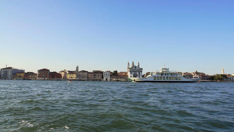 Touristic ship sailing along embankment with attractions in Venice, transport Footage