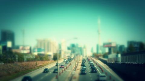 Traffic entering a city. Swing tilt miniature style Footage