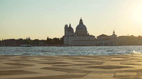 Vaporettos floating on Grand canal along Santa Maria della Salute church, Venice Footage