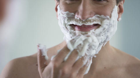 Handsome man satisfied with his new shaving product, qualitative male cosmetics Footage