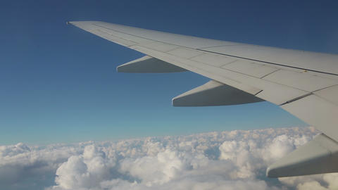 Aerial view from the airplane on cumulus clouds Footage