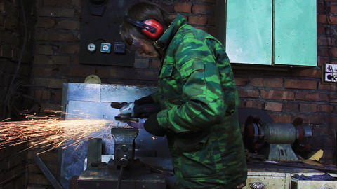 Man Working With Angle Grinder Footage