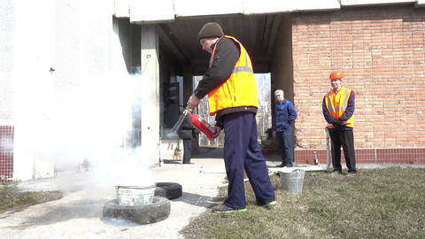 Man using fire extinguisher Footage
