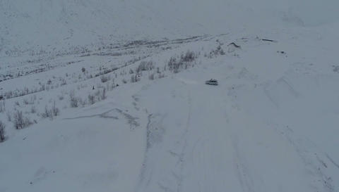 Car On The Snowy Hills Footage