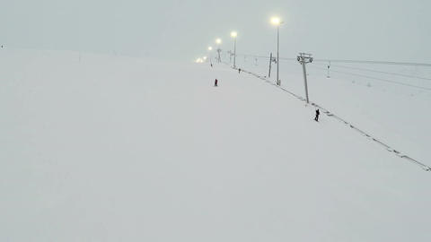 Chair Lifts And Skiers On Slope Footage