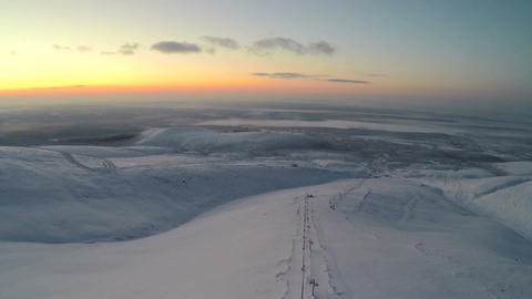 Flying over the snowfield in the evening Footage