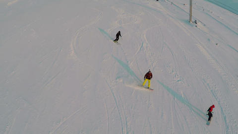 Aerial view of skiers and snowboarders Footage