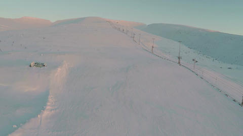 Aerial shot of empty ski-run and lift Footage