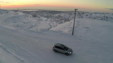 Aerial view of car driving snowy road and drifting Footage