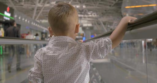 Little kid on flat escalator in trade center Footage