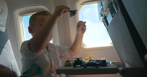Child playing with toys during the flight Footage