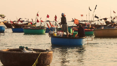 Closeup Round Vietnamese Fishing Boats Float on Sea Footage