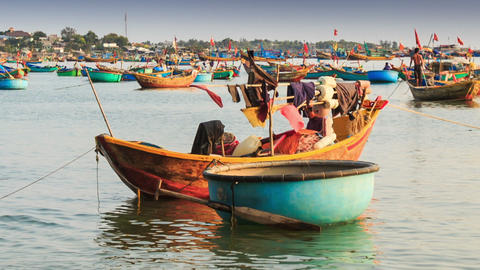 Round and Long Fishing Boats Float in Sea Bay in Vietnam Footage