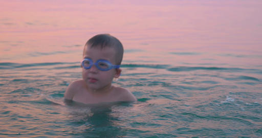 Boy Diving and Splashing in Sea Water Footage