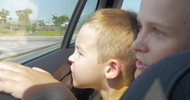 Mother and son looking out car window Footage