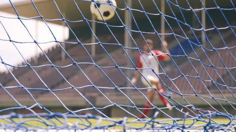Football player scoring a goal Footage