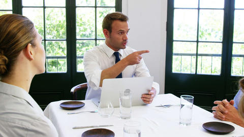 Businessman explaining a thing to his colleagues Footage