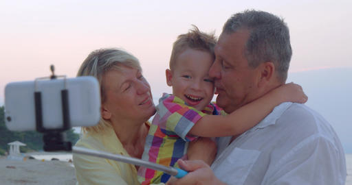Family mobile selfie with child and grandparents Footage