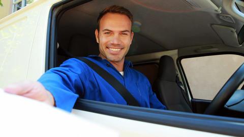 Delivery man sitting in his van Footage