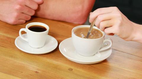 Woman stirring her coffee Footage